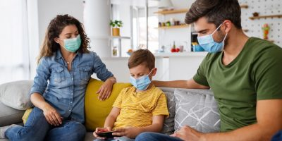 Beautiful Young Family Wearing Face Masks Against 38DLDNA