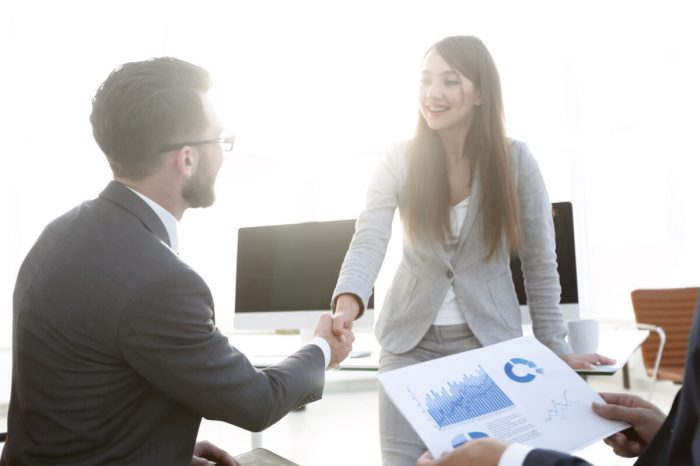 welcome and handshake of business people in the office. the concept of partnership
