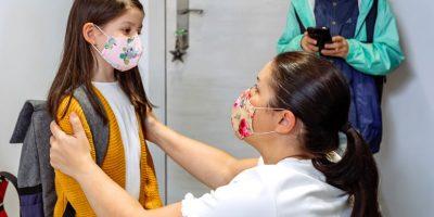 Mother Advising Daughter About Coronavirus Precaut SH5L7PV