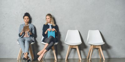 Young Multicultural Businesswomen Sitting On Chair 2UPYPA2